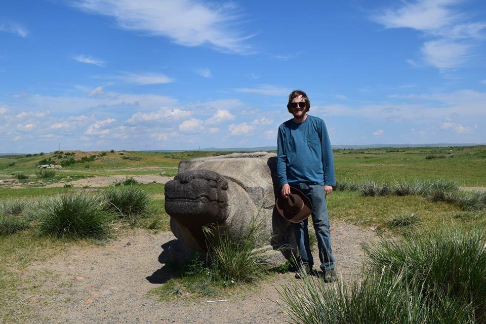a man by a sculpted rock