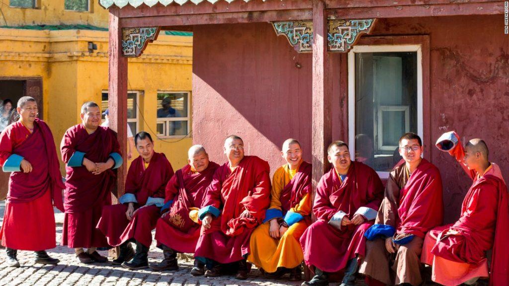 monks sitting outside