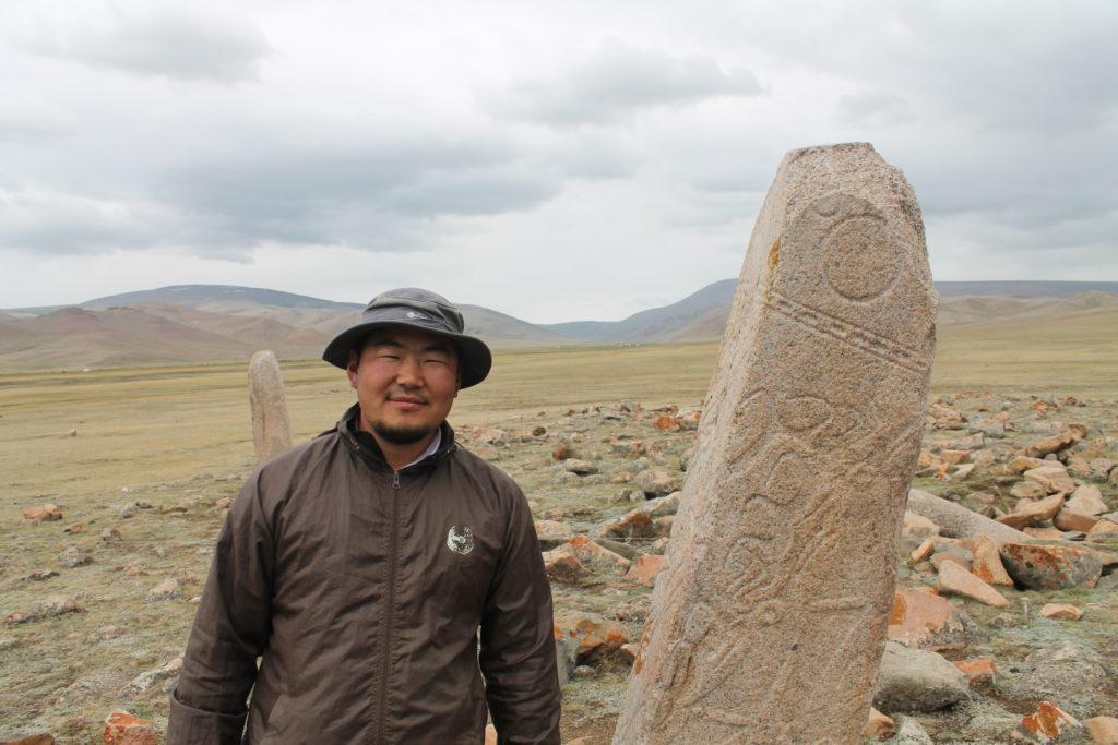 a man by a carved pillar